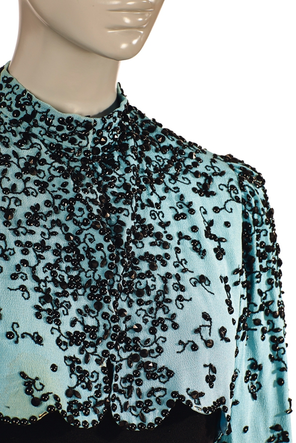 Schiaparelli A bolero jacket in ice blue crepe  1940  Estimate €15,000-20,000 £14,000-18,000 $21,000-27,000.jpg