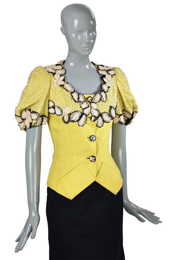 Schiaparelli Yellow fitted jacket, with beadwork and black and white floral trim, 1940s €10-15,000.jpg